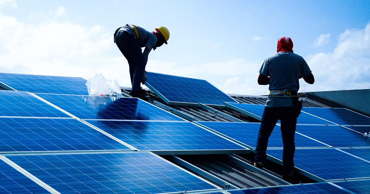 Installing a Solar Cell on a Roof. shutterstock
