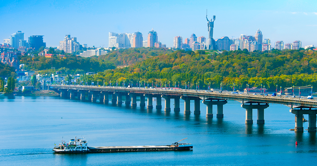 Skyline of Kiev with Dnipro river, Paton bridge and Mother Motherland monument.
